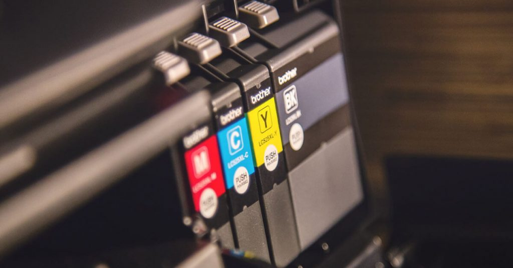 Image of printer's CMYK slots indicating printers compatibility